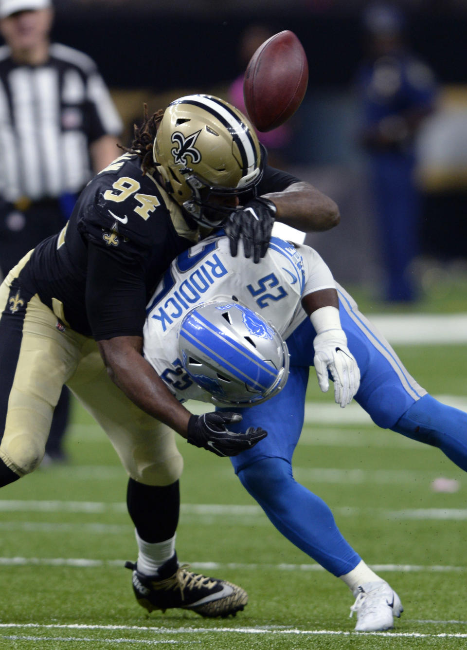 <p>New Orleans Saints defensive end Cameron Jordan (94) forces Detroit Lions running back Theo Riddick (25) to to lose the football on a pass play, resulting in an interception in the second half of an NFL football game in New Orleans, Sunday, Oct. 15, 2017. (AP Photo/Bill Feig) </p>