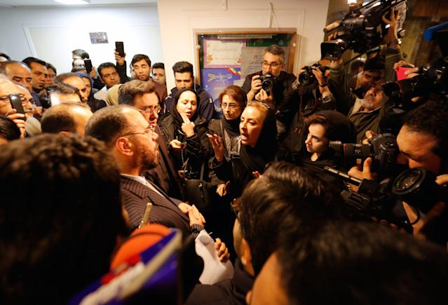 <p>An unidentified relative of one of the crewmen who were onboard 'Sanchi' oil tanker that sunk off the coast of China complains to an official of the government inside the Iranian company in Tehran, Iran, Jan. 14, 2018. (Photo: EFE/EPA/Abedin Taherkenareh) </p>