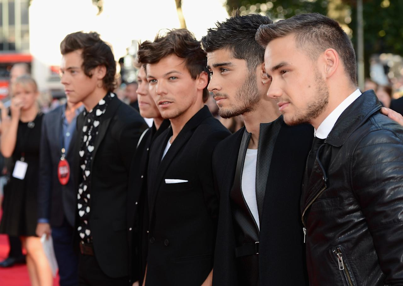 "LONDON, ENGLAND - AUGUST 20: (L-R) Singers Harry Styles, Niall Horan, Louis Tomlinson, Zayn Malik and Liam Payne from One Direction attend the ""One Direction This Is Us"" world premiere at the Empire Leicester Square on August 20, 2013 in London, England. (Photo by Ian Gavan/Getty Images for Sony Pictures)"