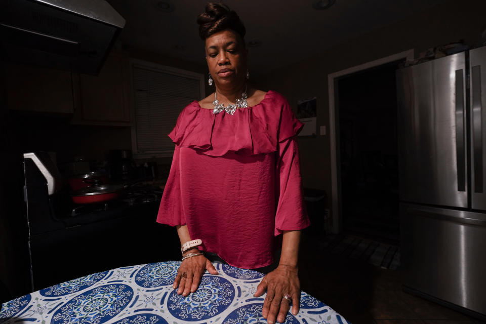 Karla Jefferies stands in her kitchen in Detroit, Friday, March 5, 2021. Doctors can't find anything to explain her lingering coronavirus symptoms, and she bristles when some doctors dismiss them as nothing serious. ''I understand that COVID is something that we're all going through together but don't brush me off,'' said Jefferies, 64, a retired state worker in Detroit. (AP Photo/Paul Sancya)