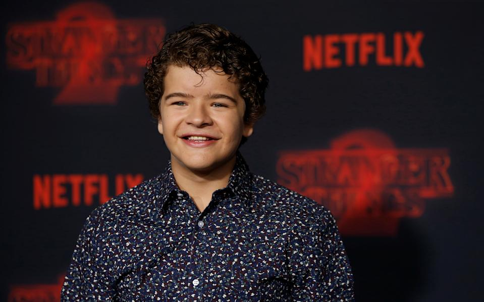 """Cast member Gaten Matarazzo poses at the premiere for the second season of the television series """"Stranger Things"""" in Los Angeles, California, U.S., October 26, 2017. REUTERS/Mario Anzuoni"""