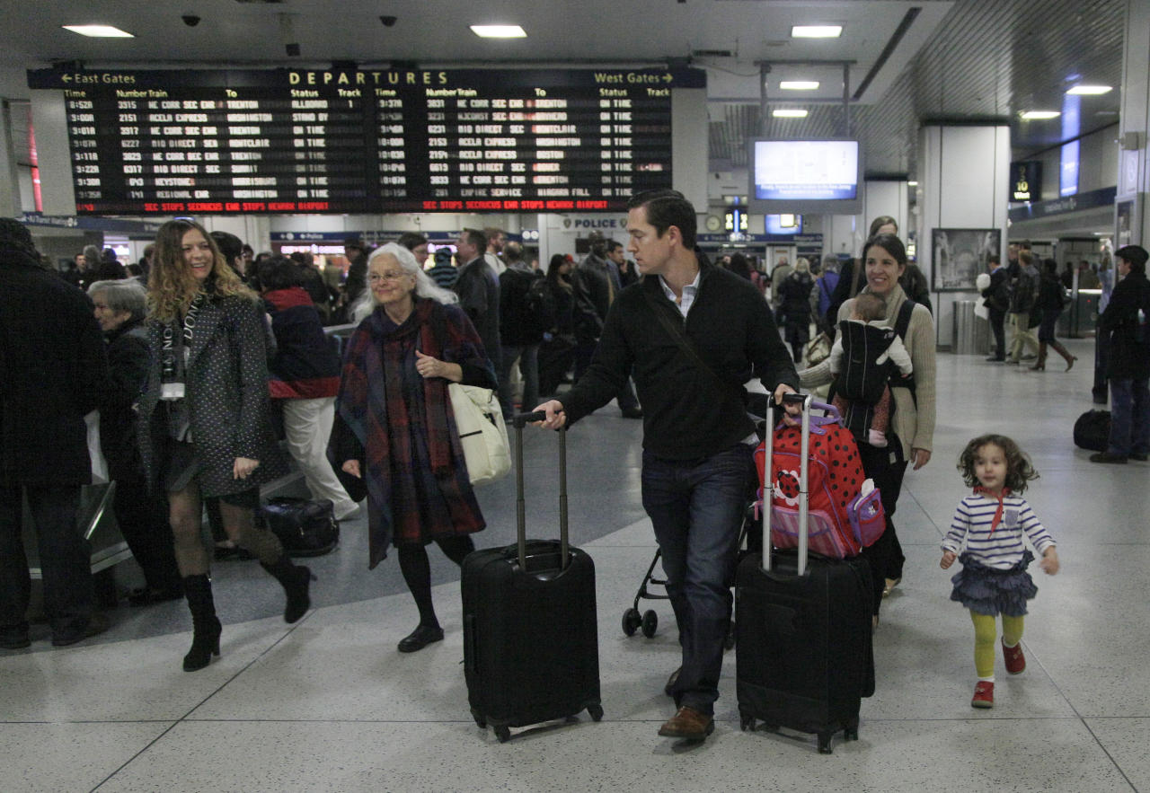 Travelers walk through New York's Penn Station, Wednesday, Nov. 21, 2012. Around 43.6 million Americans were expected to journey 50 miles or more between Wednesday and Sunday, just a 0.7 percent increase from last year, according to AAA's yearly Thanksgiving travel analysis. (AP Photo/Richard Drew)