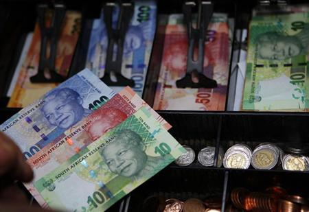"""South Africa's new banknotes, which features an image of former president Nelson Mandela on the front and images of the country's """"Big Five"""" wild animals on the reverse, are seen in a till as they go into official circulation in Pretoria"""