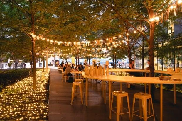 An outdoor terrasse in downtown Montreal last August. 'This summer, we want people to walk in an urban forest,' the head of the downtown merchants' association says.