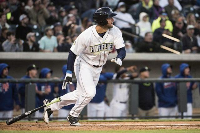 Tim Tebow looks up after launching a home run in his first at-bat with the Columbia Fireflies. (AP Photo/Sean Rayford)
