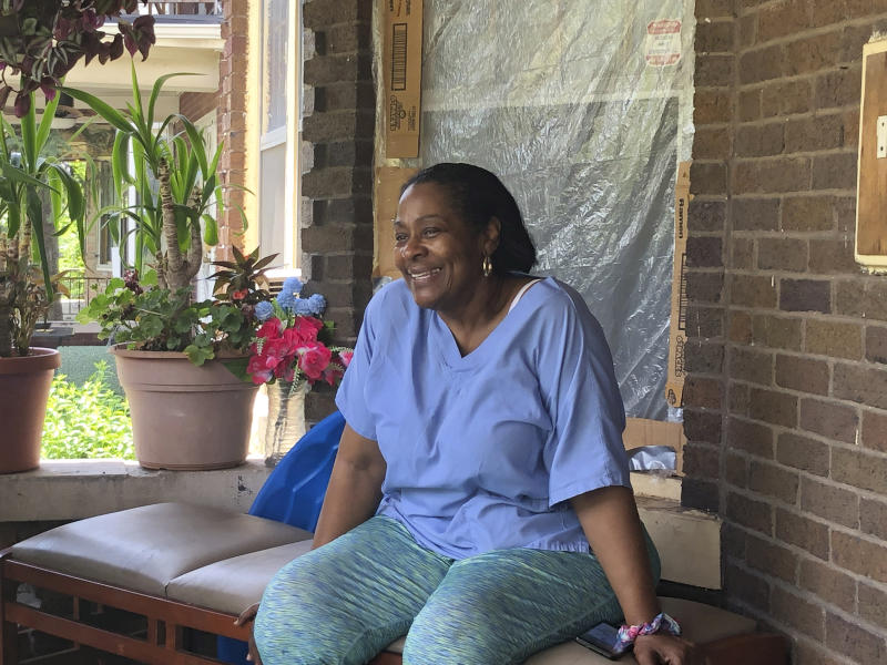 "Deloris Knight of Detroit, Mich., sits on her front porch, Wednesday, July 17, 2019, as she prepares for the heat wave that will descend upon Detroit and a wide section of the Midwest. Knight said she will keep the heat out of her Eastside Detroit home by keeping her doors and curtains closed while running the small window air conditioner in the living room. ""We have a couple of big fans. We have ceiling fans,"" Knight, 63, said while enjoying Wednesday's more comfortable 80-plus degree weather from her front porch. (AP Photo Corey Williams)"