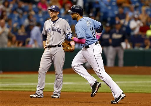 Tampa Bay Rays' James Loney, right, rounds the bases in front of San Diego Padres third baseman Chase Headley during the eighth inning of an interleague baseball game Sunday, May 12, 2013, in St. Petersburg, Fla. The Rays won 4-2. (AP Photo/Mike Carlson)
