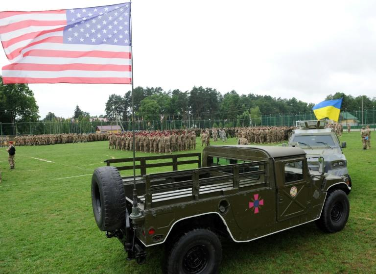 Ukrainian and US flags are flown at the opening of drills in western Ukraine's Lviv district in July 2015