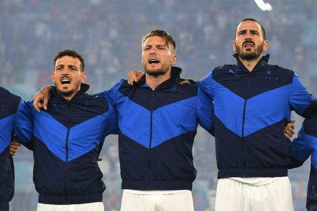 ROME, ITALY - JUNE 11: (L - R) Alessandro Florenzi, Ciro Immobile and Leonardo Bonucci of Italy line up to sing the national anthem prior to the UEFA Euro 2020 Championship Group A match between Turkey and Italy at the Stadio Olimpico on June 11, 2021 in Rome, Italy. (Photo by Claudio Villa/Getty Images) (Photo: Claudio Villa via Getty Images)