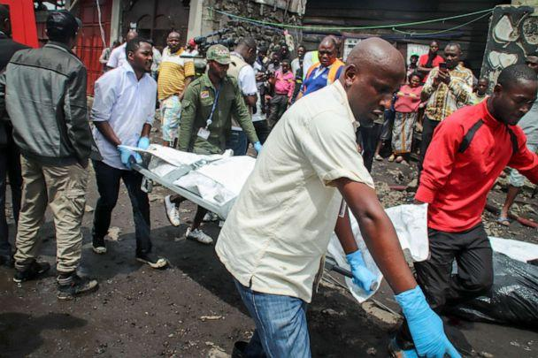 PHOTO: Rescuers remove bodies from the debris of an aircraft operated by private carrier Busy Bee which crashed in Goma, Congo, Nov. 24, 2019. (Justin Kabumba/AP)