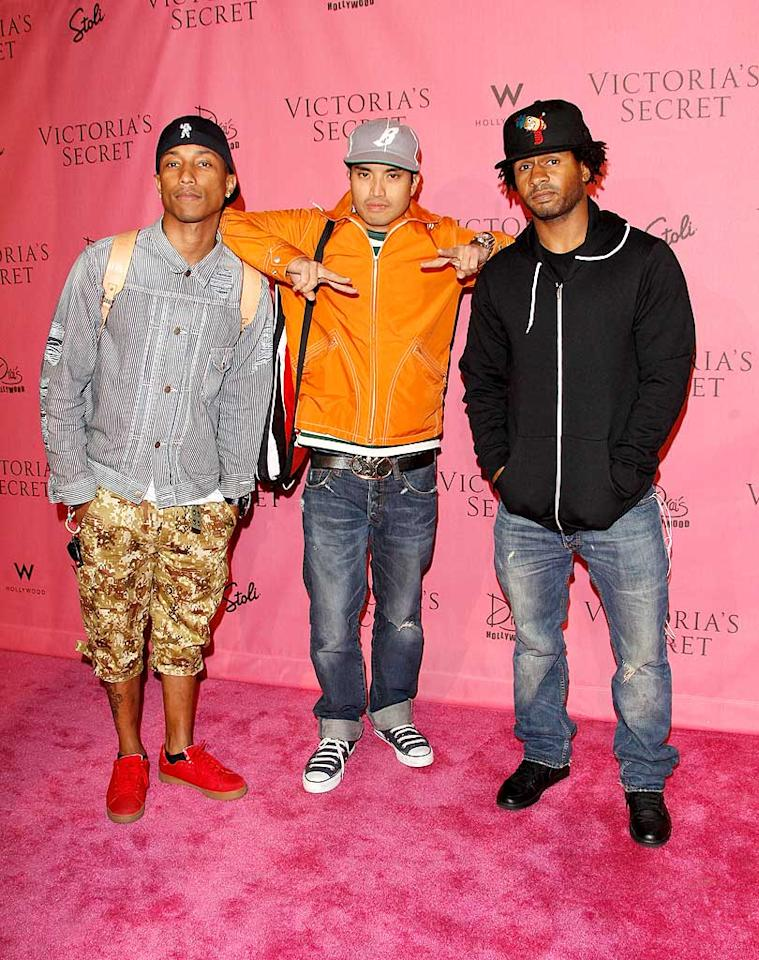 """Pharrell Williams and his N.E.R.D. band mates Chad Hugo and Shay Haley rocked a casual vibe at the event that proclaimed Katy Perry as Sexiest Songstress. Todd Williamson/<a href=""""http://www.wireimage.com"""" target=""""new"""">WireImage.com</a> - May 11, 2010"""