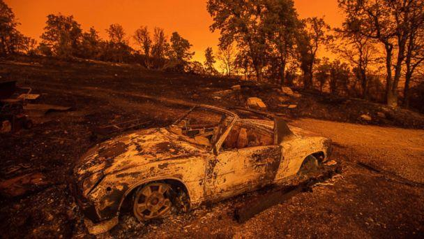Cars scorched by the Carr Fire rest at a residence in Redding, Calif., on Friday, July 27, 2018. The fire rapidly expanded Thursday when flames swept through the Gold Rush town of Shasta, then jumped the Sacramento River into Redding. (AP)