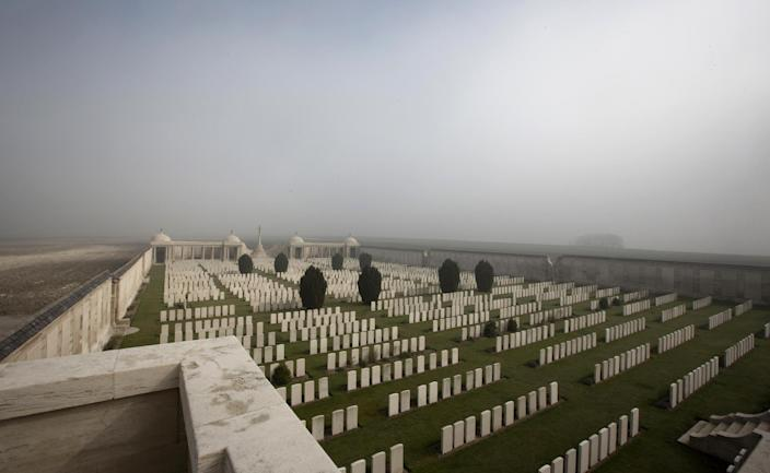 Mist gathers on the horizon at Dud's Corner World War One Cemetery in Loos-en-Gohelle, France on Thursday, March 13, 2014. Private William McAleer, of the 7th Battalion, Royal Scots Fusiliers, was killed in action on Sept. 26, 1915 during the Battle of Loos and his name has been on the wall of the missing at Dud's Corner for nearly 100 years. His body was found and identified in 2010, during routine construction in the area, and he will be reburied with full military honors at the Loos British Cemetery on Friday, March 14, 2014. (AP Photo/Virginia Mayo)
