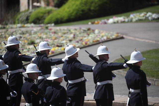 Members of the Royal Marines line the route of the procession