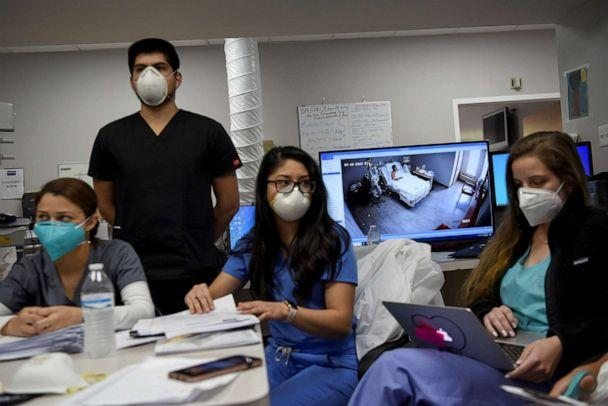 PHOTO: Live camera footage of a patient hospitalised with COVID-19 is shown from a computer monitor during a daily meeting lead by Dr. Joseph Varon at United Memorial Medical Center (UMMC) in Houston, Texas, July 10, 2020. (Callaghan O'hare/Reuters)