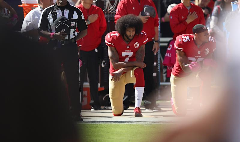 San Francisco 49ers quarterback Colin Kaepernick kneeling during the national anthem
