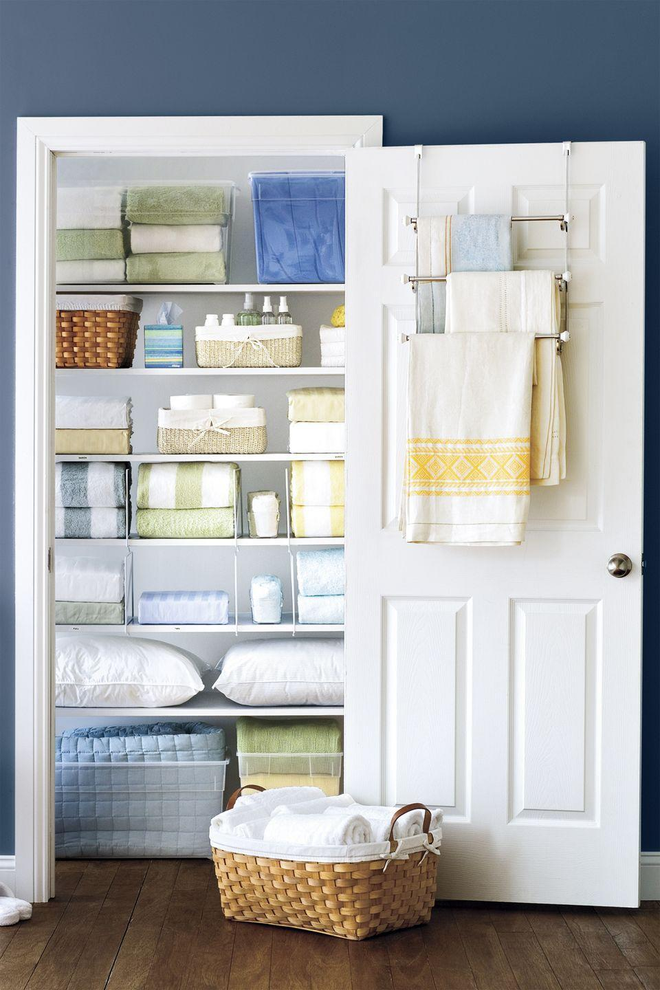 """<p>They're not just for bathrooms. An over-the-door hanger creates out-of-sight storage space for extra tablecloths, throws, or towels. </p><p><a class=""""link rapid-noclick-resp"""" href=""""https://www.amazon.com/Franklin-Brass-193153-FN-Triple-Nickel/dp/B01JUD4PUI/?tag=syn-yahoo-20&ascsubtag=%5Bartid%7C10055.g.2610%5Bsrc%7Cyahoo-us"""" rel=""""nofollow noopener"""" target=""""_blank"""" data-ylk=""""slk:SHOP TOWEL RACKS"""">SHOP TOWEL RACKS</a></p><p><strong>RELATED: </strong><a href=""""https://www.goodhousekeeping.com/home/organizing/g2911/linen-closet-organization-tricks"""" rel=""""nofollow noopener"""" target=""""_blank"""" data-ylk=""""slk:Seriously Smart Linen Closet Organization Ideas"""" class=""""link rapid-noclick-resp"""">Seriously Smart Linen Closet Organization Ideas</a></p>"""