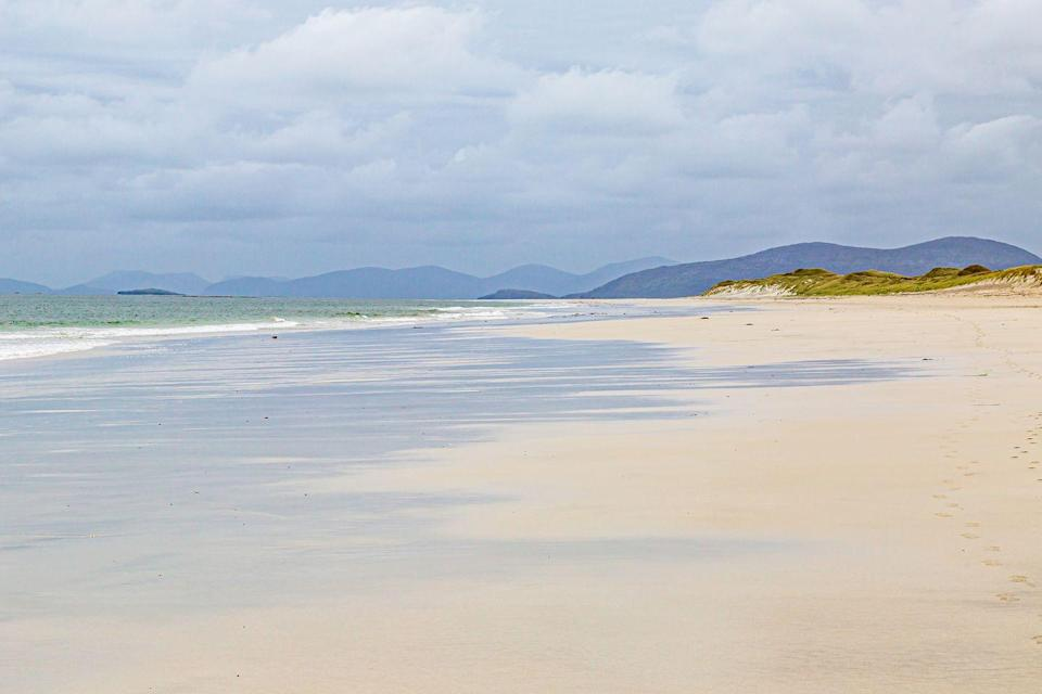 "<p>West Beach runs the entire length of Berneray, an isle in the North Uist, Outer Hebrides. It's comprised of three miles of white sand, and is completely unspoiled - perfect for walking along or having a picnic nearby. </p><p><a class=""link rapid-noclick-resp"" href=""https://go.redirectingat.com?id=127X1599956&url=https%3A%2F%2Fwww.booking.com%2F&sref=https%3A%2F%2Fwww.cosmopolitan.com%2Fuk%2Fentertainment%2Ftravel%2Fg4958%2Fbest-beaches-in-uk%2F"" rel=""nofollow noopener"" target=""_blank"" data-ylk=""slk:FIND ACCOMMODATION"">FIND ACCOMMODATION </a></p>"