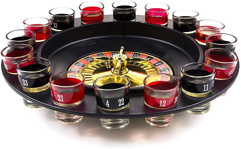 <p>Take their game nights to the next level with this <span>Shot Glass Roulette </span> ($16). It comes with two balls and 16 glasses and will bring a dash of Vegas to their house parties. </p>