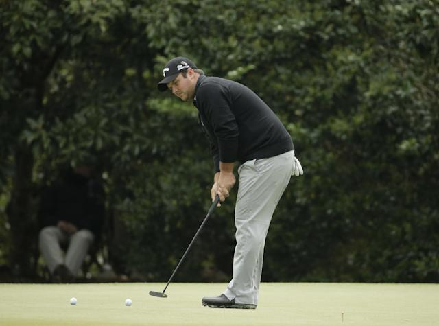 Patrick Reed putts on the 11th green during a practice round for the Masters golf tournament Tuesday, April 8, 2014, in Augusta, Ga. (AP Photo/Chris Carlson)