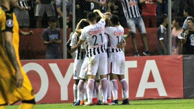 Former Benfica striker Oscar Cardozo was the hero, his 90th-minute free-kick preserving Libertad's 100 per cent record in Group Three.