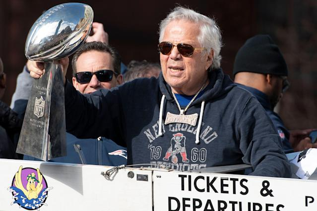 "Robert Kraft holds the Vince Lombardi Trophy during the <a class=""link rapid-noclick-resp"" href=""/nfl/teams/new-england/"" data-ylk=""slk:Patriots"">Patriots</a>' celebration parade in Boston on Feb. 5, 2019. (Getty Images)"