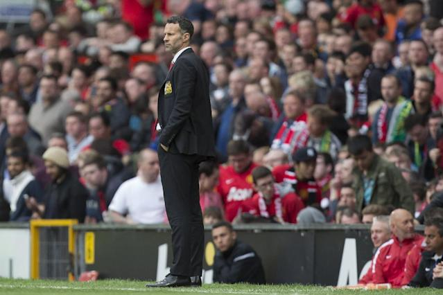 Manchester United's interim manager Ryan Giggs watches his team's 4-0 win against Norwich City in their English Premier League soccer match at Old Trafford Stadium, Manchester, England, Saturday April 26, 2014. (AP Photo/Jon Super)