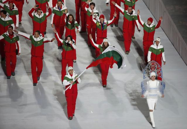Bulgaria's flag-bearer Maria Kirkova leads her country's contingent during the opening ceremony of the 2014 Sochi Winter Olympics, February 7, 2014. REUTERS/Lucy Nicholson (RUSSIA - Tags: OLYMPICS SPORT)