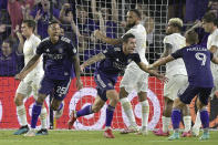 Orlando City defender Kyle Smith, center, celebrates after scoring a goal as defender Antonio Carlos (25) and forward Chris Mueller (9) come to congratulate him during the first half of an MLS soccer match against Atlanta United, Friday, July 30, 2021, in Orlando, Fla. (Phelan M. Ebenhack/Orlando Sentinel via AP)
