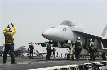 An F/A-18E Super Hornet prepares to launch from the flight deck of the aircraft carrier USS Nimitz