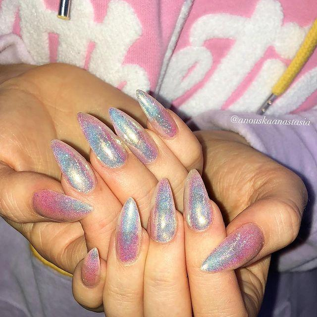 """<p>Layer a coat of glitter over a duochrome base for nails that look like they belong to Ariel.</p><p><a href=""""https://www.instagram.com/p/BiRwDOyn82c/"""" rel=""""nofollow noopener"""" target=""""_blank"""" data-ylk=""""slk:See the original post on Instagram"""" class=""""link rapid-noclick-resp"""">See the original post on Instagram</a></p>"""