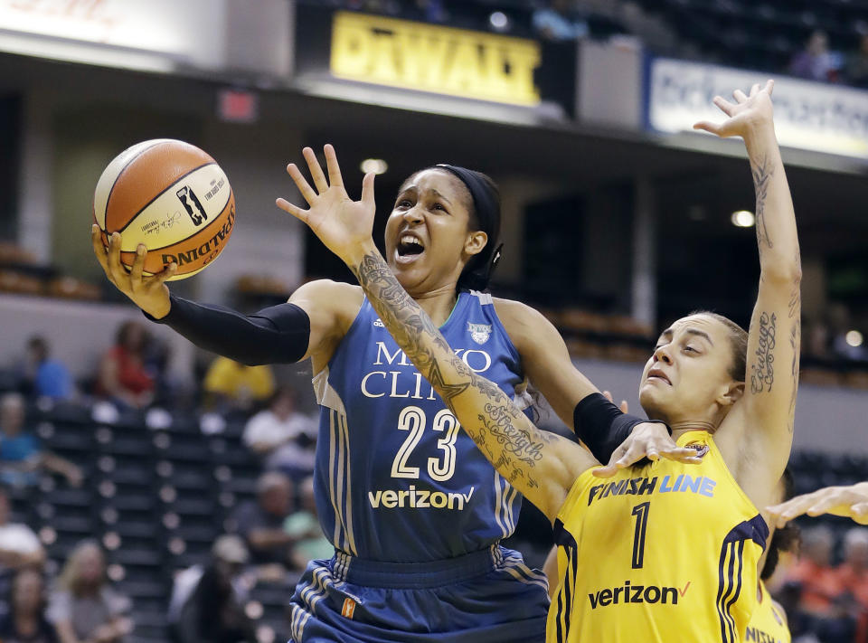 Minnesota Lynx's Maya Moore shoots against Indiana Fever's Jazmon Gwathmey during the first half of a WNBA basketball game Wednesday, Aug. 30, 2017, in Indianapolis. (AP Photo/Darron Cummings)
