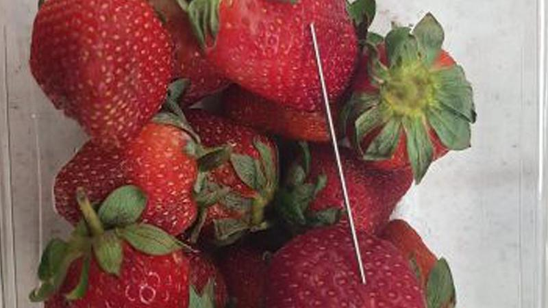 A third brand of strawberries are being removed from shelves after needles were found in the fruit