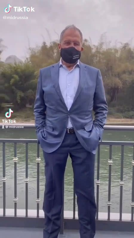 Russia's Foreign Minister Sergei Lavrov wearing a protective face mask poses for a picture in Guilin