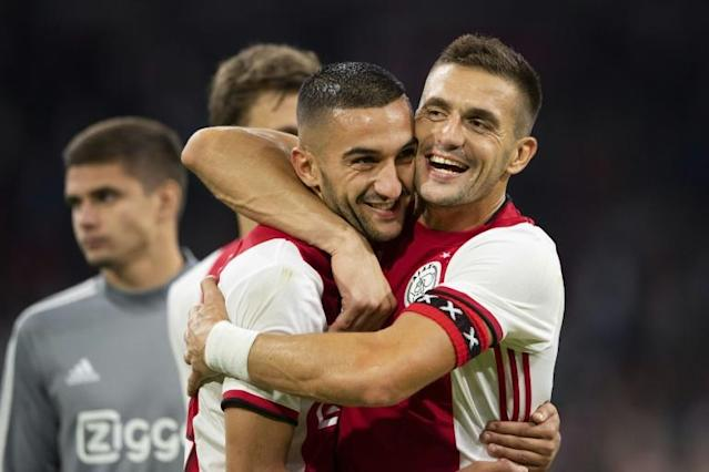 Dusan Tadic (R) fired Ajax into the Champions League playoff with two penalties (AFP Photo/Olaf KRAAK)