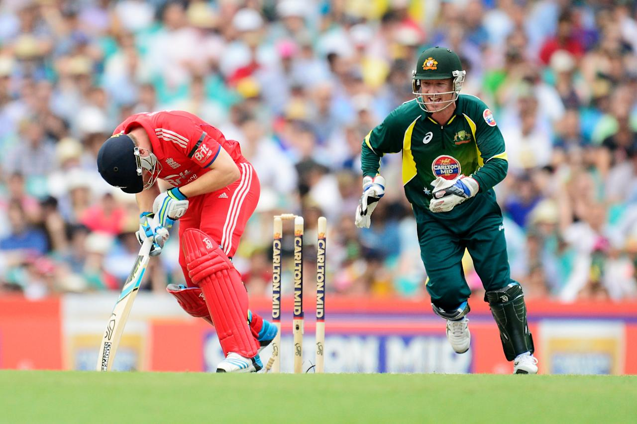 SYDNEY, AUSTRALIA - JANUARY 19: Jos Buttler of England deflects the ball onto his stumps during game three of the One Day International Series between Australia and England at Sydney Cricket Ground on January 19, 2014 in Sydney, Australia.  (Photo by Brett Hemmings/Getty Images)