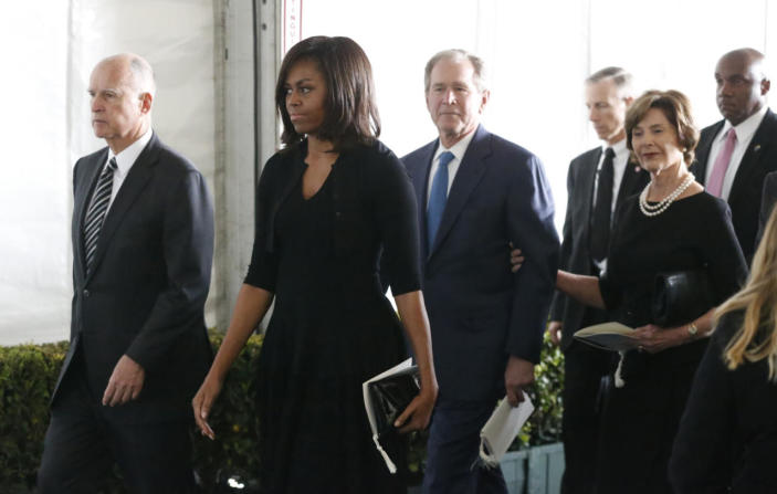 <p>California Gov. Jerry Brown, first lady Michelle Obama, former President George W. Bush and former first lady Laura Bush leave after the funeral of Nancy Reagan at the Ronald Reagan Presidential Library.<i> (Photo: Reuters)</i></p>