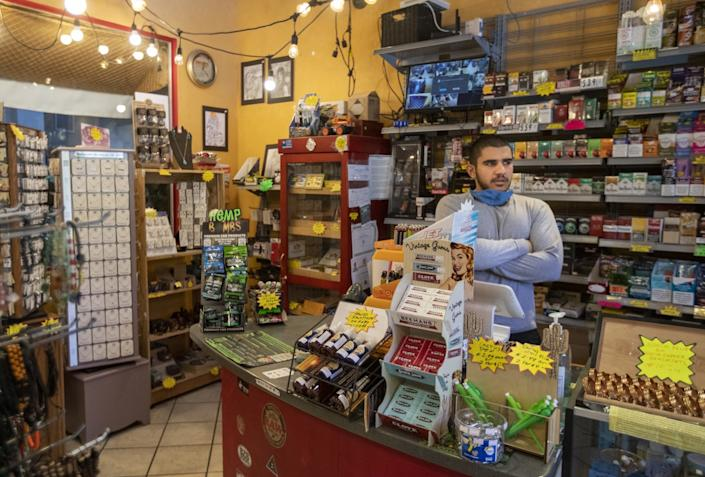"Hassan Sowid works part time at his uncle's store, Mel's Bisbee Bodega. Sowid wants to study medicine and become a nurse. <span class=""copyright"">(Brian van der Brug / Los Angeles Times)</span>"
