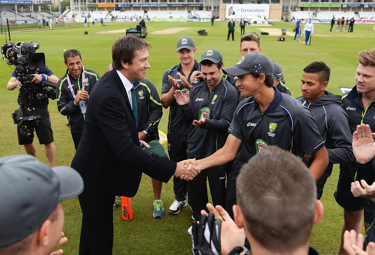NOTTINGHAM, ENGLAND - JULY 10:  Ashton Agar of Australia receives his Baggy Green cap on his Test debut from former Australian fast bowler Glenn McGrath prior to day one of the 1st Investec Ashes Test match between England and Australia at Trent Bridge Cricket Ground on July 10, 2013 in Nottingham, England.  (Photo by Gareth Copley/Getty Images)