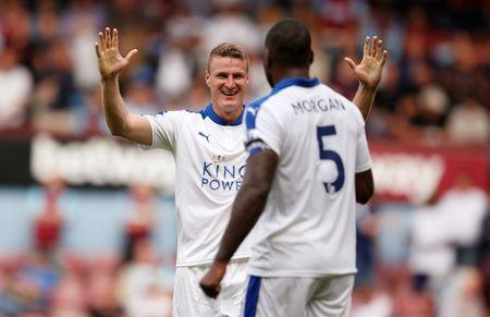Leicester's Robert Huth and Wes Morgan celebrate after the game Mandatory Credit: Action Images / John Sibley Livepic