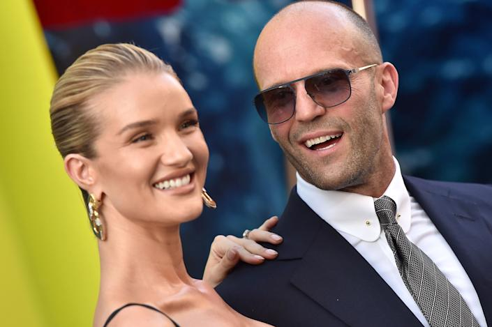 HOLLYWOOD, CA - AUGUST 06: Rosie Huntington-Whiteley and Jason Statham attend the premiere of Warner Bros. Pictures and Gravity Pictures' 'The Meg' at TCL Chinese Theatre IMAX on August 6, 2018 in Hollywood, California. (Photo by Axelle/Bauer-Griffin/FilmMagic)