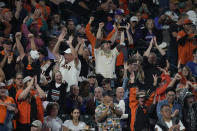 Fans cheer after San Francisco Giants' Mike Yastrzemski hit a three-run home run off Colorado Rockies relief pitcher Ashton Goudeau in the seventh inning of a baseball game Friday, Sept. 24, 2021, in Denver. (AP Photo/David Zalubowski)