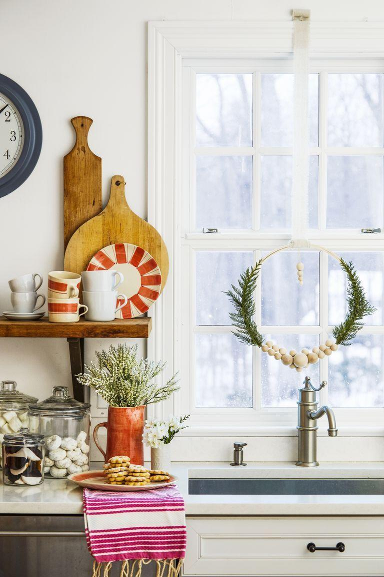 <p>If you do it right, then you can hang up your decorations before Christmas and leave 'em up all winter long. These wreaths, decked out with wooden beads and artificial pine branches, really shine on any blank wall, window, or door. </p>
