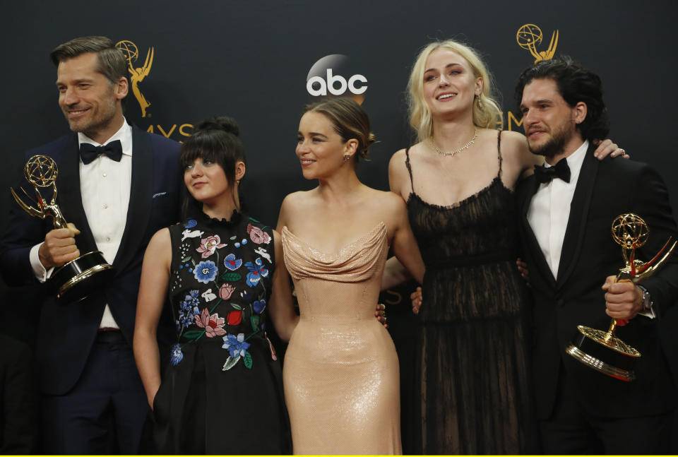 "Nikolaj Coster-Waldau (L), Maisie Williams, Emilia Clarke, Sophie Turner and Kit Harrington of HBO's ""Game of Thrones"" pose backstage with their award for Oustanding Drama Series at the 68th Primetime Emmy Awards in Los Angeles, California U.S., September 18, 2016.  REUTERS/Mike Blake"