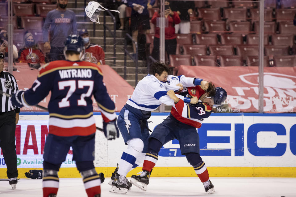 Tampa Bay Lightning defenseman Luke Schenn (2) loses his helmet during a brawl with Florida Panthers left wing Ryan Lomberg (94) during the second period of an NHL hockey game on Saturday, May 8, 2021, in Sunrise, Fla. (AP Photo/Mary Holt)