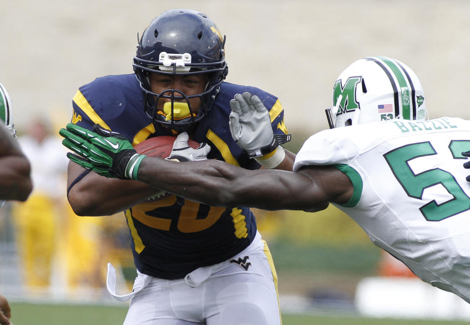MORGANTOWN, WV - SEPTEMBER 01:  Shawne Alston #20 of the West Virginia Mountaineers carries the ball against the Marshall Thundering Herd during the game on September 1, 2012 at Mountaineer Field in Morgantown, West Virginia.  (Photo by Justin K. Aller/Getty Images)