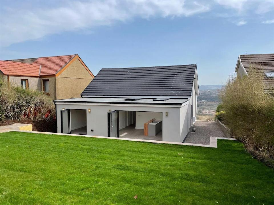 """<p>Looking to move closer to the sea? Well, why not consider this contemporary bungalow in Swansea. Renovated to a high standard, it has a modern <a href=""""https://www.housebeautiful.com/uk/decorate/kitchen/a36556398/kitchen-worktops/"""" rel=""""nofollow noopener"""" target=""""_blank"""" data-ylk=""""slk:kitchen"""" class=""""link rapid-noclick-resp"""">kitchen</a>, ample living space and unrivalled views you have to see to believe. </p><p>This property is currently on the market for £279,000 with Perfect Pads via <a href=""""https://www.zoopla.co.uk/for-sale/details/58144585/"""" rel=""""nofollow noopener"""" target=""""_blank"""" data-ylk=""""slk:Zoopla"""" class=""""link rapid-noclick-resp"""">Zoopla</a>.</p>"""