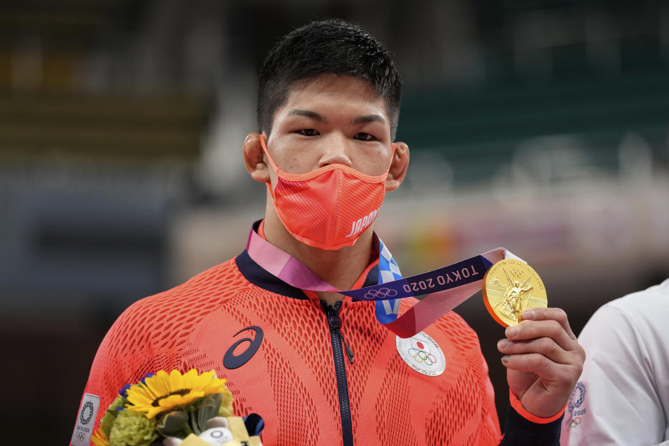 Gold medalist Shohei Ono of Japan poses after the medal ceremony for men's -73kg judo, at the 2020 Summer Olympics in Tokyo, Japan, Monday, July 26, 2021. (AP Photo/Vincent Thian)