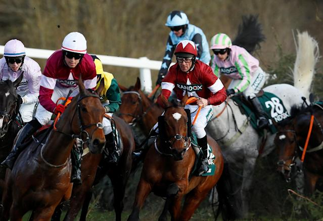 Horse Racing - Grand National Festival - Aintree Racecourse, Liverpool, Britain - April 14, 2018 Tiger Roll ridden by Davy Russell (C) in action at Canal Turn before winning the 17:15 Randox Health Grand National Handicap Chase Action Images via Reuters/Jason Cairnduff