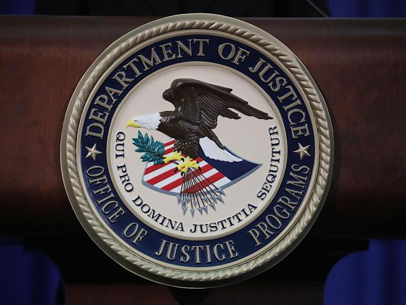 The Justice Department seal is seen on the lectern during a Hate Crimes Subcommittee summit on 29 June 2017 in Washington, DC: (Getty Images)